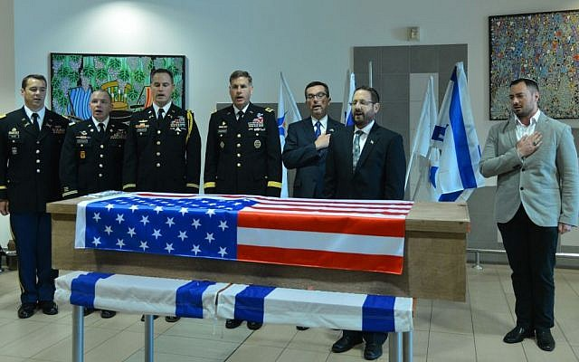 Israeli and American officials participate in a goodbye ceremony for Taylor Force, the US citizen killed in a stabbing terror attack in Jaffa, as his body is sent back to be buried in the United States, at Ben Gurion Airport near Tel Aviv, on Friday, March 11, 2016. (Flash90)