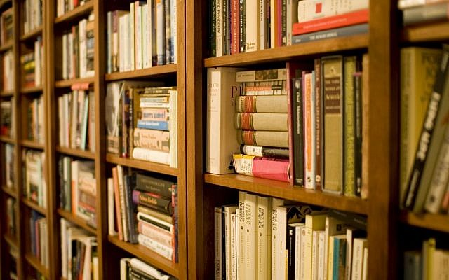 Illustrative photo of shelves filled with books. (CC BY 2.0 Stewart Butterfield/Wikipedia)