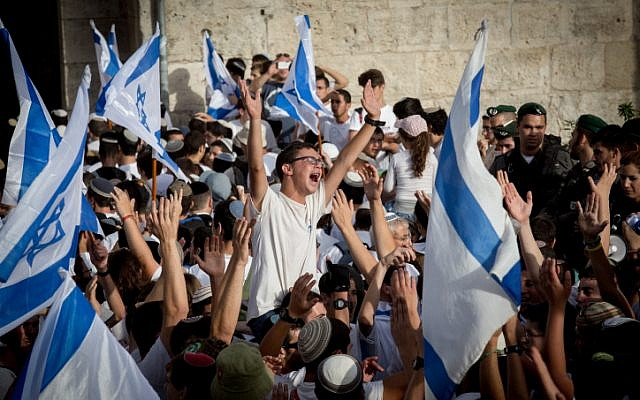 Illustrative. Thousands of young Jewish boys wave Israeli flags as they celebrate Jerusalem Day, dancing and marching their way through Damascus Gate on the way to the Western Wall of Jerusalem's Old City, June 5, 2016. (Nati Shohat/Flash90)