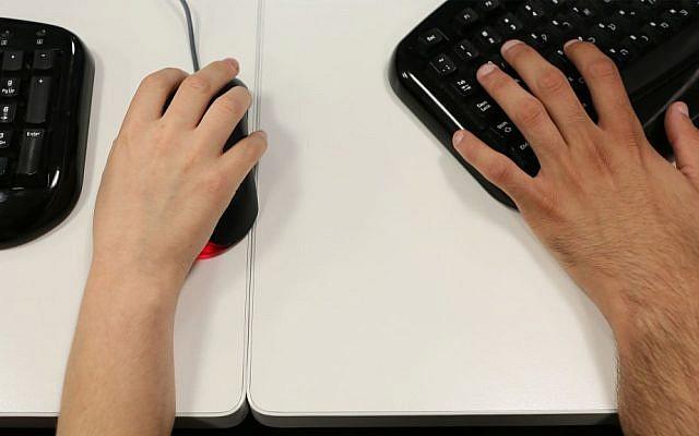 Illustrative photo of people using computers. (Nati Shohat/Flash90)