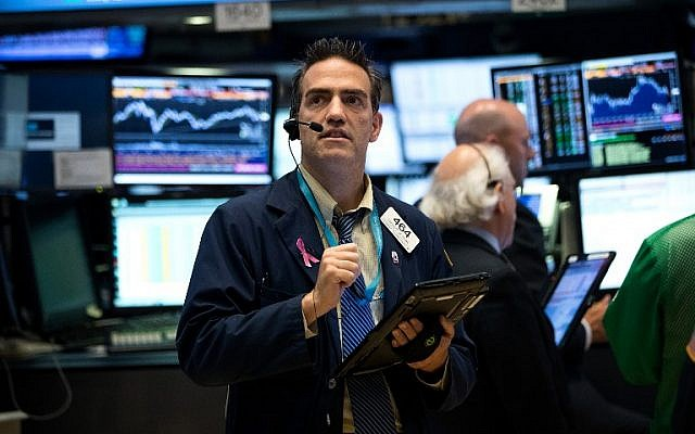 Illustrative: A trader works on the floor of the New York Stock Exchange, July 12, 2016 (Drew Angerer/Getty Images/AFP)