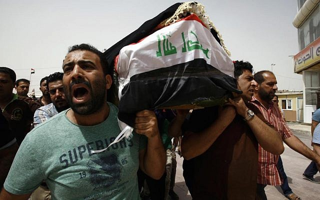 Iraqi men carry a coffin in the holy Iraqi city of Najaf during a funeral procession for the victims of a suicide bombing that ripped through Baghdad's busy shopping district of Karrada on July 3, 2016. (AFP/Haidar HAMDANI)