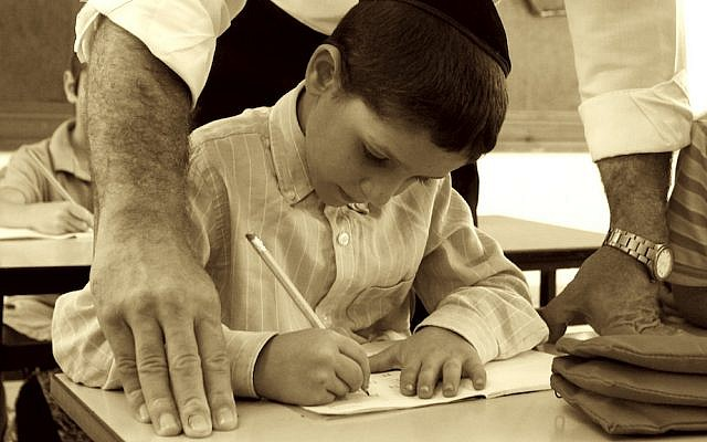Illustrative photo: Israeli orthodox child studying in his classroom (Abir Sultan/Flash 90)