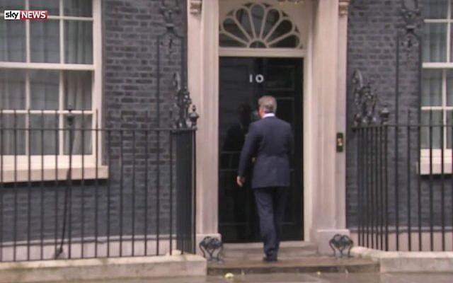 Outgoing British Prime Minister David Cameron, humming to himself, enters his official residence at 10 Downing Street on July 11, 2016 after announcing he would step down two days later. (YouTube screen capture)