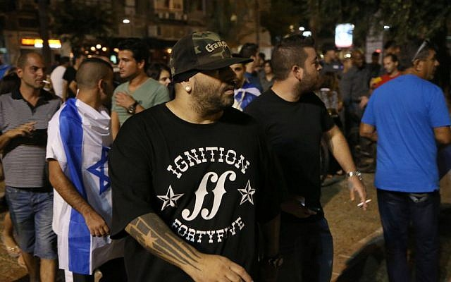 Israeli rap singer Yoav Eliasi takes part at a right wing demonstration in support of Israel's offensive in the Gaza Strip, in Tel Aviv, Israel, August 9, 2014. (Flash90)