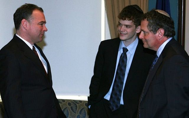 Then-Virginia Gov. Tim Kaine, left, speaking with Rabbi Jack Moline and Moline's son Max at the Virginia Statehouse. (Courtesy of Jack Moline)