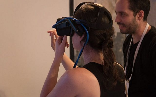 A woman uses virtual reality to furnish the interior of a home at the DLD Tel Aviv Innovation Festival. September 27, 2016. (Luke Tress/Times of Israel)