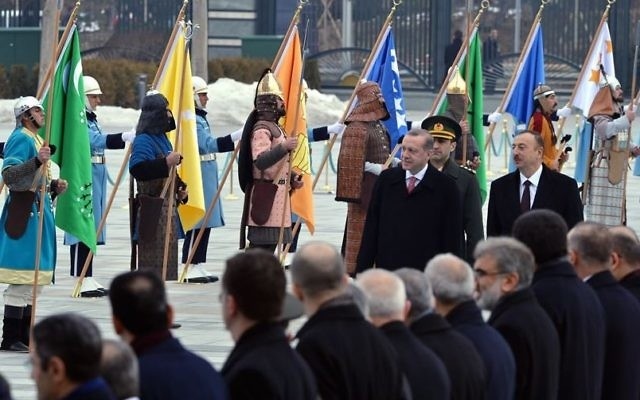 President Recep Tayyip Erdogan greeting Azeri President Ilham Aliyev on January 15, 2016, in the presence of 16 soldiers dressed in ceremonial costumes representing various Turkic people in history. (Official website of the President of Turkey)