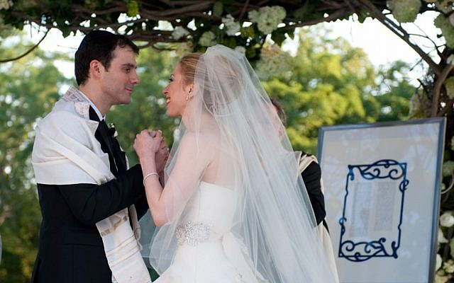 Marc Mezvinsky and Chelsea Clinton combined Jewish and Methodist traditions during their wedding ceremony on July 31, 2010. (Genevieve de Manio, via JTA)