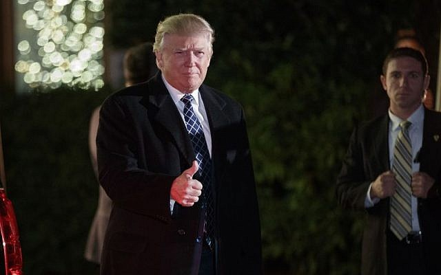 President-elect Donald Trump gestures toward reporters as he arrives for a party at the home of Robert Mercer, one of his biggest campaign donors, December 3, 2016, in Head of the Harbor, N.Y. (AP Photo/Evan Vucci)