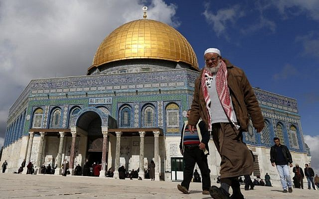 A Palestinian man walks past the Dome of Rock at the Al-Aqsa Mosque compound before the Friday prayer in Jerusalem's Old City on January 13, 2017. (AFP/Ahmad Gharabli)