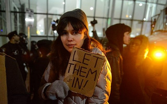 Protestors rally during a demonstration against the new immigration ban issued by President Donald Trump at John F. Kennedy International Airport, in New York City, January 28, 2017. (Stephanie Keith/Getty Images/AFP)