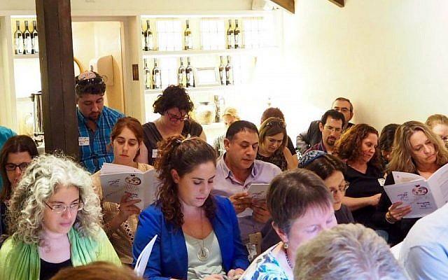 Illustrative: A group of Israeli Reform rabbis, including Rabbi Tamir Nir (center, purple shirt), read from a festive tractate marking Diaspora-Israel Day on November 13, 2016 in Tel Aviv. (Facebook)