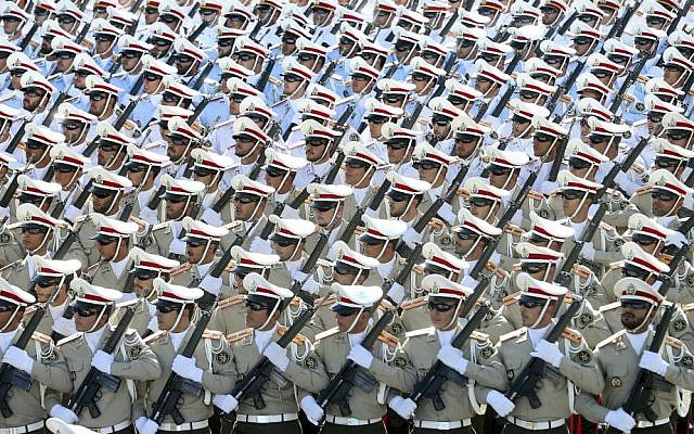 In this Sept. 21, 2016 file photo, Iranian armed forces members march in a military parade marking the 36th anniversary of Iraq's 1980 invasion of Iran, in front of the shrine of late revolutionary founder Ayatollah Khomeini, just outside Tehran, Iran. (AP Photo/Ebrahim Noroozi, File)