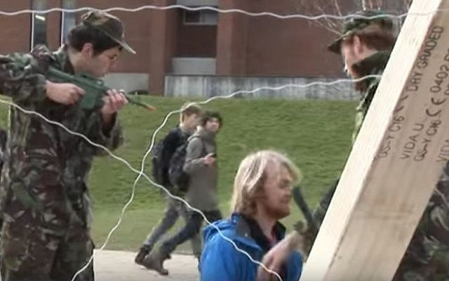Illustrative: Students at the UK's Sussex University staging a mock Israeli checkpoint during Israel Apartheid Week, March, 2012. (screen capture: YouTube/File)