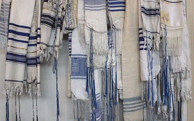 A rack of prayer shawls at Congregation B'nai Israel shows the unique style of tzitzit used by Karaite Jews. (David A.M. Wilensky)