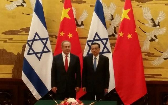 China's Premier Li Keqiang and  Prime Minister Benjamin Netanyahu attend a signing ceremony at the Great Hall of the People in Beijing on March 20, 2017 (Raphael Ahren / Times of Israel)