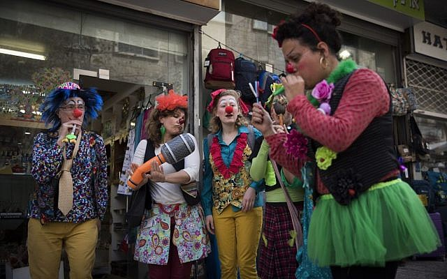 Illustrative: Israelis dress up in costumes in central Jerusalem ahead of the Jewish holiday of Purim on March 10, 2017. (Yonatan Sindel/ Flash90)