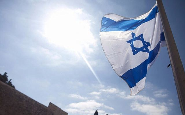 An Israeli flag at the Western Wall in Jerusalem on Holocaust Remembrance Day, April 24, 2017. (Lior Mizrahi/Flash90)