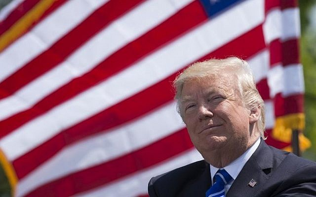 US President Donald Trump attends the US Coast Guard Academy commencement ceremony in New London, Connecticut, on May 17, 2017. (AFP Photo/Saul Loeb)