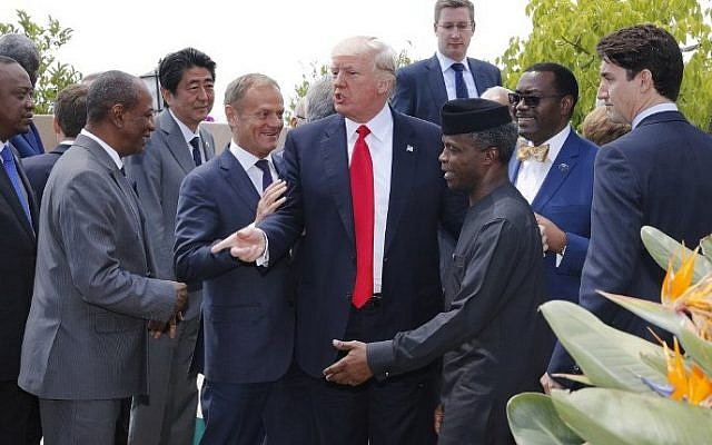 European Council President Donald Tusk (4th L), US President Donald Trump (C), Japanese Prime Minister Shinzo Abe (3rd L) and Canadian Prime Minister Justin Trudeau (R) pose with African leaders after the family photo at the end of the expanded session during the Summit of the Heads of State and of Government of the G7, the group of most industrialized economies, plus the European Union, on May 27, 2017 in Taormina, Sicily.  (AFP PHOTO / POOL / PHILIPPE WOJAZER)