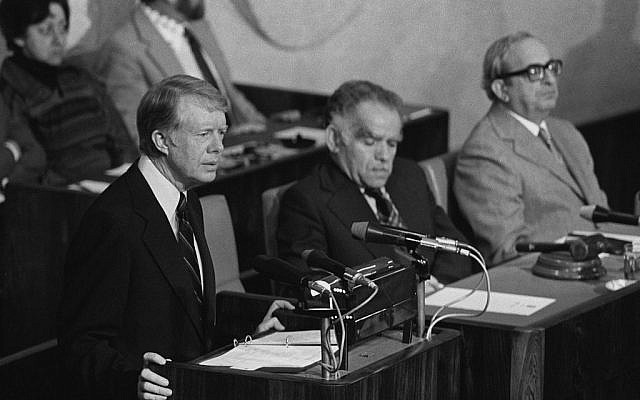 US president Jimmy Carter, left, addresses the Knesset plenary, Jerusalem, March 1979 (Yaacov Saar/GPO)
