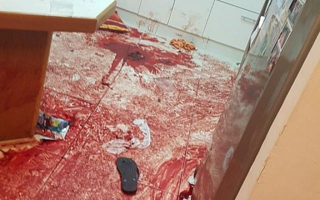 Blood is seen in the kitchen of an Israeli family that was attacked by a terrorist on Friday evening, July 21, 2017. At least three people were stabbed to death and a fourth person wounded in the attack. (IDF Spokesperson's Unit)
