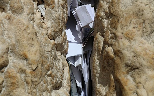 Letters in the spaces between stones of the Western Wall in Jerusalem (iStock)