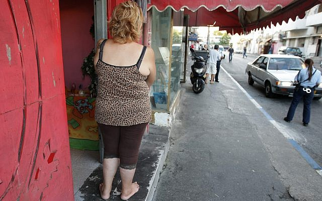 A female prostitute stands outside a brothel in south Tel Aviv, looking at a police woman near by. Sep 21, 2008. Photo by Kobi Gideon / FLASH90.