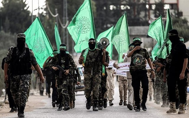 Illustrative: Masked youth cadets from the Hamas terror group's military-wing march in the southern Gaza Strip city of Khan Younis on September 15, 2017. (AFP Photo/Said Khatib)