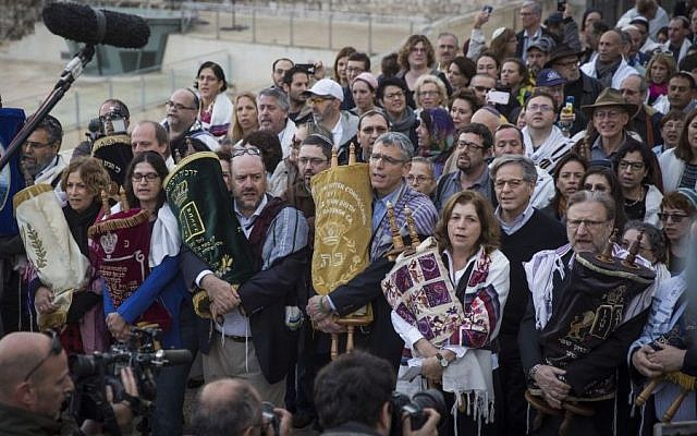 Illustrative: A group of American Conservative and Reform rabbis and the Women of the Wall movement members hold Torah scrolls during a protest march against the government's failure to deliver a new prayer space, at the Western Wall in Jerusalem Old City, November 2, 2016. (Hadas Parush/Flash90)
