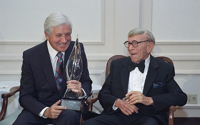 Monty Hall, left, recipient of the 2nd Annual George Burns Lifetime Award, laughs with George Burns at the United Jewish Fund tribute to humanitarian Hall, in the Century City section of Los Angeles, on March 14, 1993.(AP Photo/Julie Markes, File)