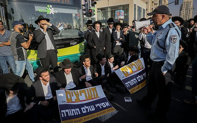 Illustrative. Ultra-Orthodox protesters block roads in Jerusalem as part of anti-draft protests, on October 17, 2017. (Yonatan Sindel/Flash90)