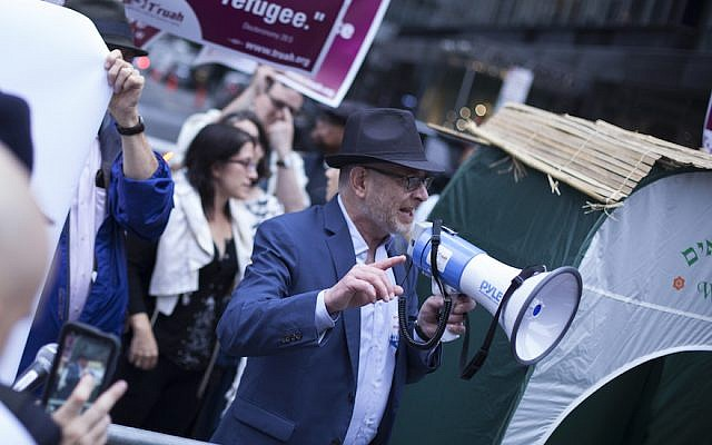 Rabbis marching for immigrants' rights outside the Trump Tower in New York, October 9, 2017. (Courtesy of T'ruah)