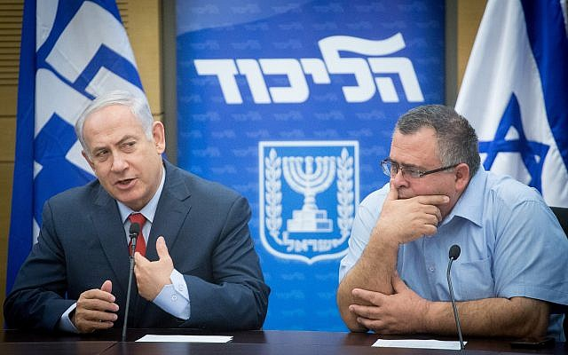 Prime Minister Benjamin Netanyahu, left, with MK David Bitan during a Likud party faction meeting at the Knesset, November 27, 2017. (Miriam Alster/Flash90)