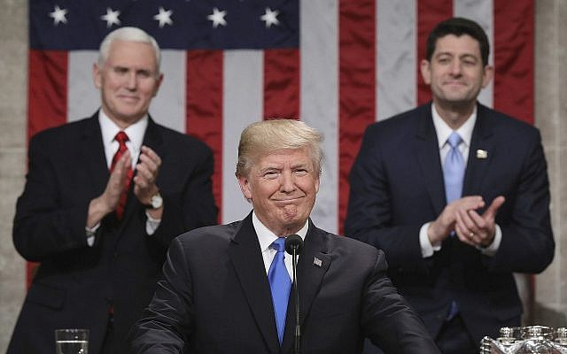 US President Donald Trump, delivering his first State of the Union address, on January 30, 2018, in Washington, DC, as Vice President Mike Pence and House Speaker Paul Ryan applaud. (Win McNamee/Pool via AP)