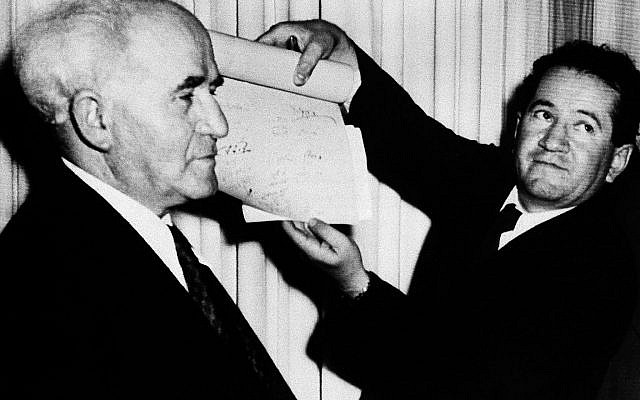 May 15, 1948: David Ben-Gurion, Israel's first prime minister, stands with an Israeli official who holds the signed document which proclaims the Establishment of the State of Israel. (AP Photo, File)