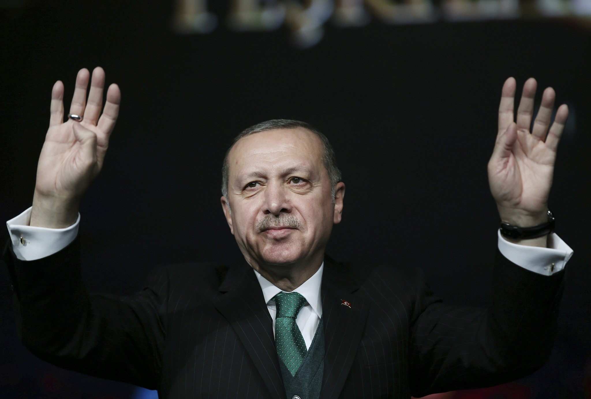 Turkey s President Recep Tayyip Erdogan gestures as he attends a national youth foundation event in Ankara