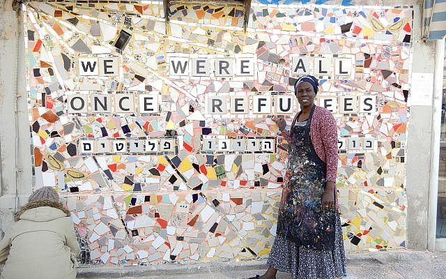 Illustrative: Lina, an asylum seeker from Sudan, with the finished mural on Rothschild Boulevard in Tel Aviv on February 21, 2018. (Melanie Lidman/Times of Israel)