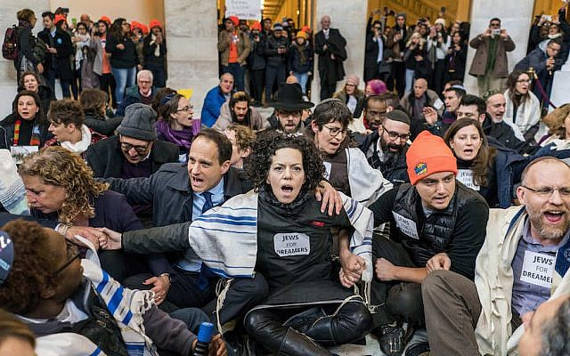 WASHINGTON, DC - Approximately 100 Jewish clergy and activists engage in civil disobedience within the Russell Senate Office Building showing support for Dreamers and a clean Dream Act on Capitol Hill in Washington DC on Wednesday January 17, 2018. (Photo by Melina Mara/The Washington Post)