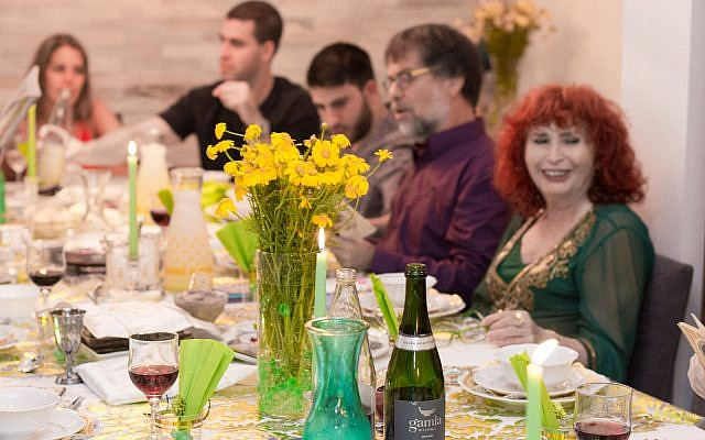 TEL AVIV - APRIL 10, 2017: Modern secular Israeli family sitting together for a traditional Passover Seder dinner