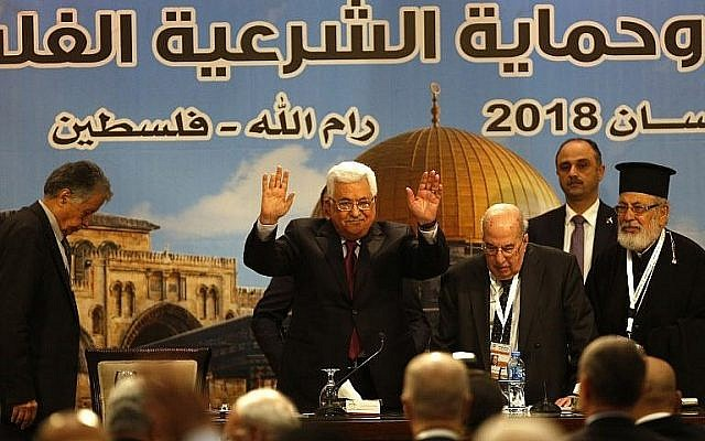 Illustrative: Palestinian Authority President Mahmoud Abbas gestures during the Palestinian National Council meeting in Ramallah on April 30, 2018. (AFP Photo/Abbas Momani)