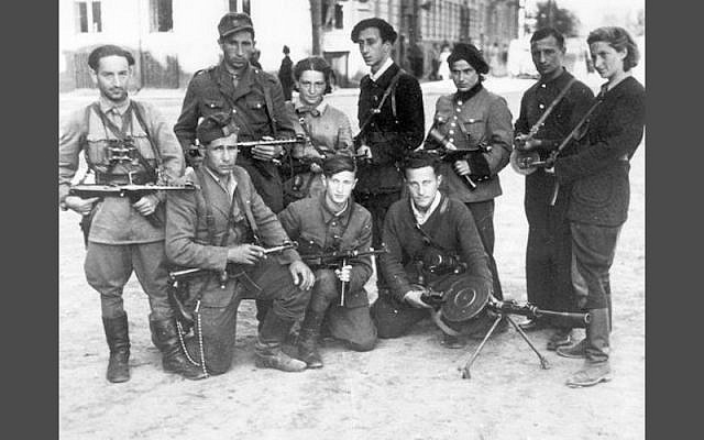 Abba Kovner (back row, center) with members of the Fareynikte Partizaner Organizatsye (The FPO – Eng: United Partisan Organization) in Vilna, 1940s (Courtesy Israel National Library)