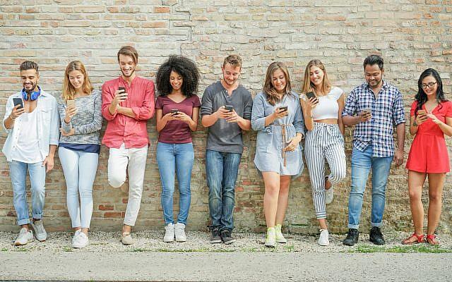 Illustrative: Millennials using cell phones. (via iStock)