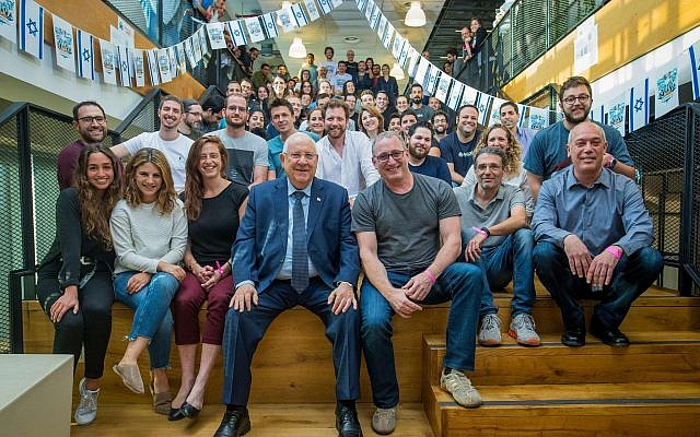 President Reuven Rivlin, left, with Waze CEO Noam Bardin, right, and the Waze team ahead of Israel's Independence Day celebrations, in April 2018. Waze featured President Rivlin's recorded driving tips for Independence Day revelers. (Victor Levy)