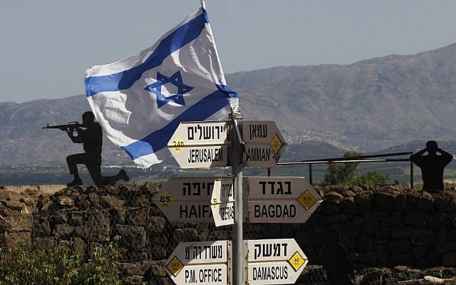 An Israeli flag is seen placed on Mount Bental in the  Golan Heights on May 10, 2018.( AFP PHOTO / JALAA MAREY)