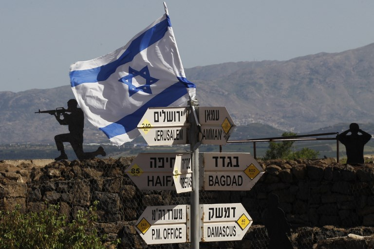 Israel will not leave the golan heights yair lapid the blogs an israeli flag is seen placed on mount bental in the golan heights on may 10 fandeluxe Choice Image