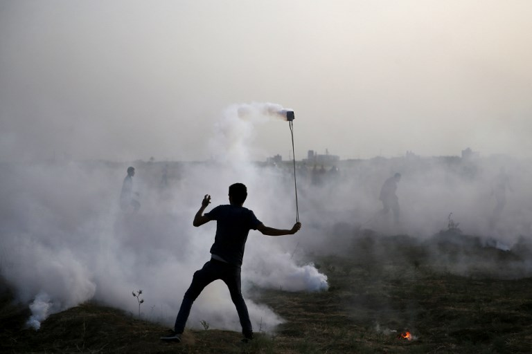 Gaza jihads latest graveyard jonathan russo the blogs illustrative image of a palestinian protester at a demonstration along the border between israel and the fandeluxe Choice Image