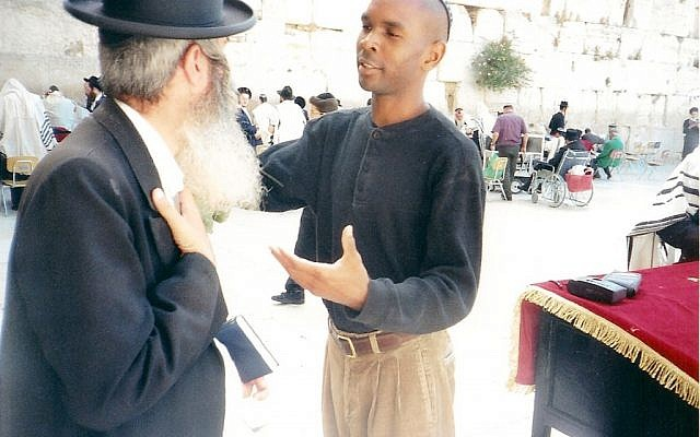 Barack Mandela talking to a rabbi at the Western Wall in Jerusalem.