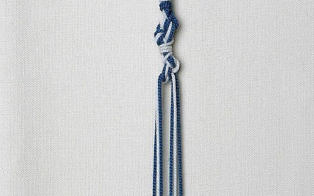 Illustrative: Tzitzit tassels with threads dyed in tekhelet blue produced from Murex trunculus snails (courtesy of Ptil Tekhelet/Eugene Weisberg)
